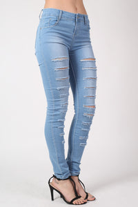 Mid Rise Multi Rip Skinny Jeans in Light Denim MODEL SIDE