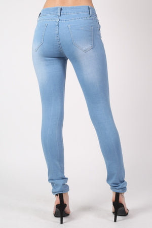 Mid Rise Multi Rip Skinny Jeans in Light Denim MODEL BACK