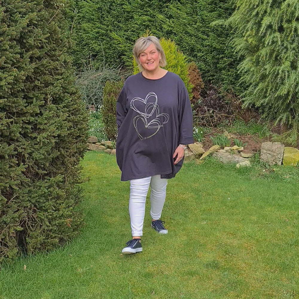 Load and play video in Gallery viewer, HELOISE MULTI HEART PRINT TUNIC SWEATSHIRT