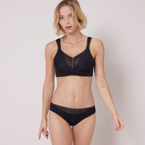 Black and mesh sports bra with gold trim