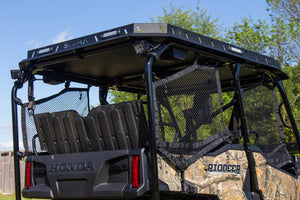 Heise 3 inch Cube Light – 90 degree flood installed on UTV underneath Swamp Ox Roof Rack.