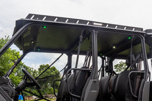 Product shot of Heise Dome/Cargo lights installed and lit in white and green on underside of Swamp Ox UTV roof rack. Six lights lit up in total, four green and two white.