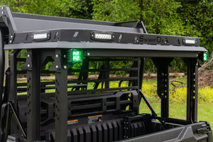 Two Heise 3 inch Green Cube lights installed on back of UTV with Swamp Ox Bed Rack.