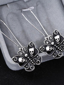 Vintage oil drop skull bow earrings