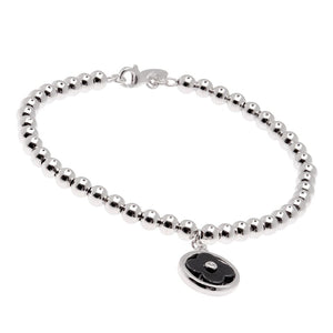 Sybella Silver, black ceramic and cubic zirconia ball bracelet