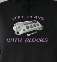 An engine block on a black hoodie with saying