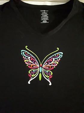 This black shirt is adorned with a multi-coloured filigree statin stitch butterfly.