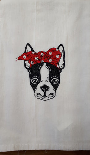 This white flour sack towel has a sketch of a Boston Terrier stitched in black. Boston Terrier is wearing a red and white polka dot bow on his head.