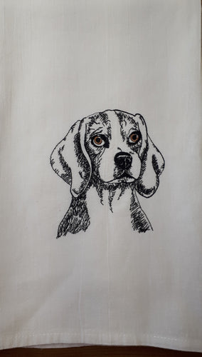 This is a flour sack towel with a sketch of a Beagle stiched in black thread.  The eyes are brown.