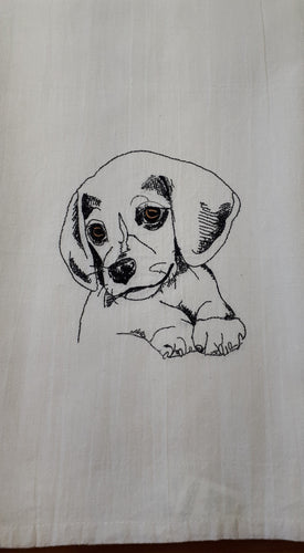 This white flour sack towel has a sketch of a cute puppy stitched with black thread.  The eyes are brown.