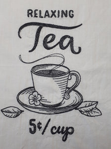 "This vintage farmers market design says ""relaxing tea five cents per cup"" in a charcoal thread on a white flour sack towel. The centre of the design is a sketch of a steaming cup of tea with leaves scattered around the base."