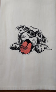 This white flour sack towel has a sketch of a puppy with his paws on the counter stitched with black thread.  The puupy's tongue is stitched in pink.