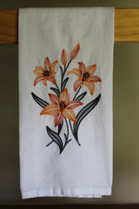 Two tones orange daylillies stitched in a sketch style with charcoal leaves and stems