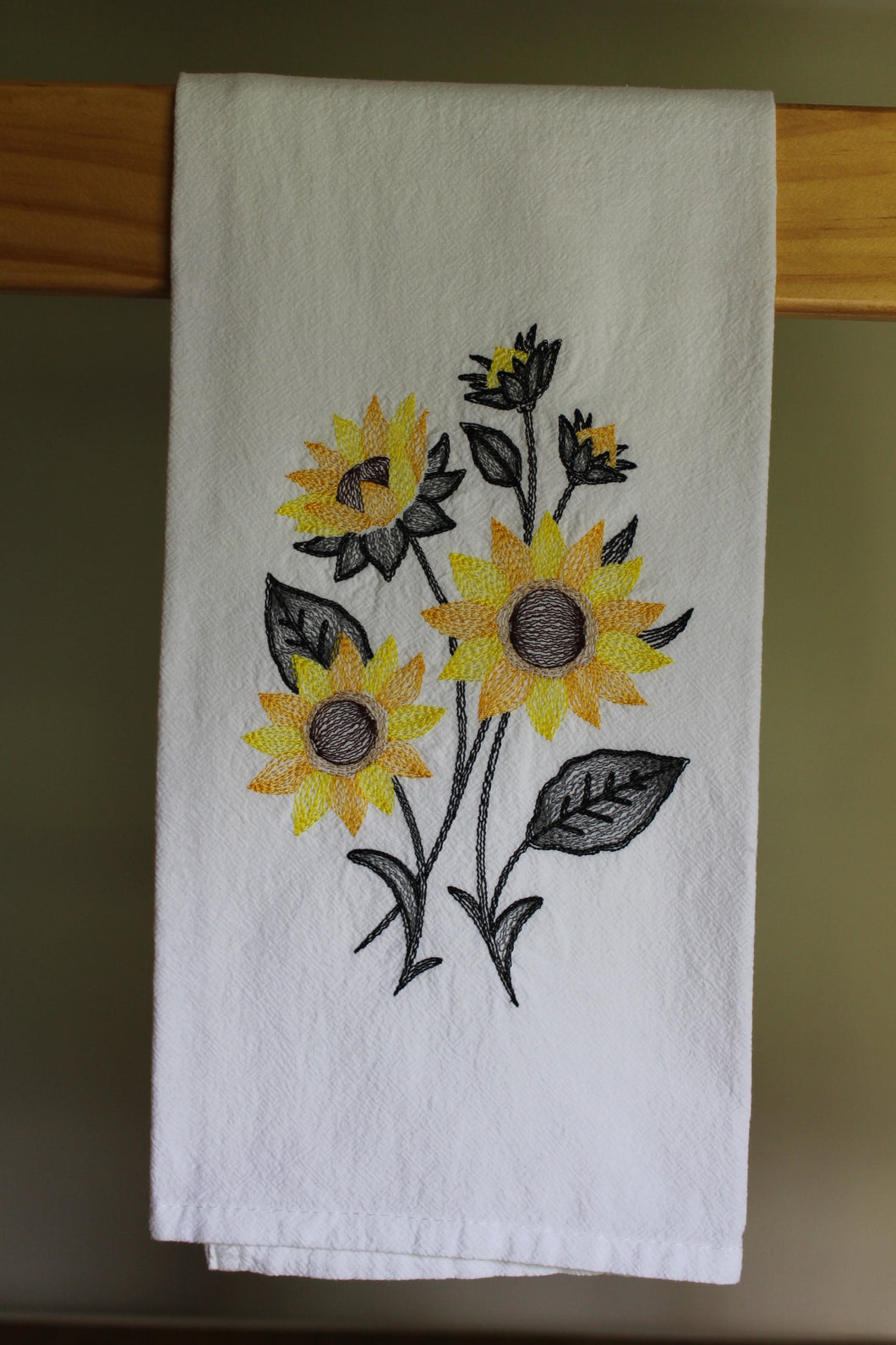 Yellow golden sunflowers in a sketch style embroidery with charchoal leaves, stems