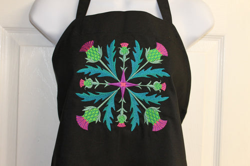 Bright, bold Scottish thistles arranged in a square on a black apron
