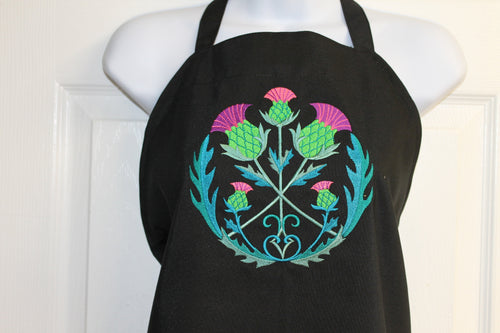 Bright, bold Scottish thistles arranged in a circle on a black apron
