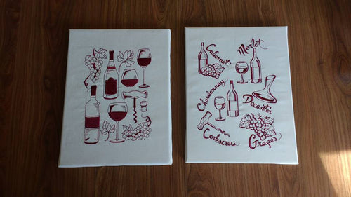These two canvas boards are stitched in burgandy thread and are wine-related.  The board on the left shows two different styles of wine bottles, 3 different types of glasses, a corkscrew and grapes.  The board on the right depicts different kinds of wine with different shaped bottles and glasses.  Cabernet, merlot, chardennay, decanter, corkscrew and grapes.