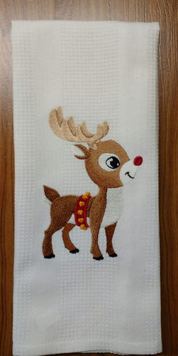 This white waffle weave towel is embroidered with a cute little reindeer with a red nose
