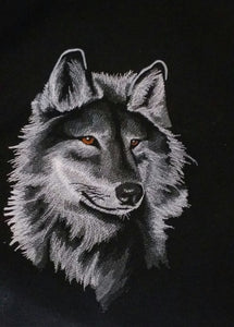 This black hoodie/swseatshirt is embroidered with a beautiful majestic wolf head.  The wolf is stiched with shades of grey and some white.  The eyes are brown.