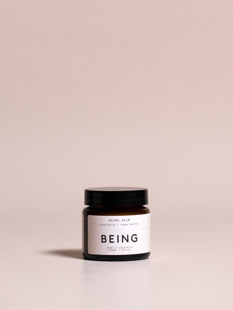 Jar of Being Skincare Being Balm against a pink background