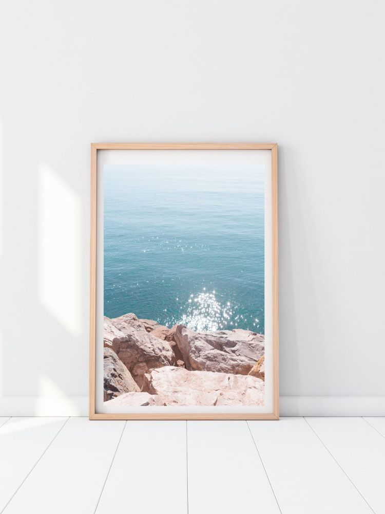 Wooden picture frame with picture of the blue sea