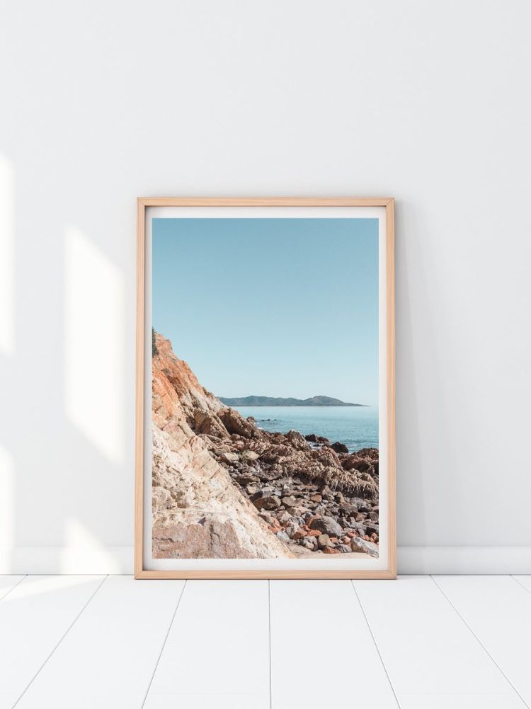 Wooden picture frame with picture of seaside cliffs