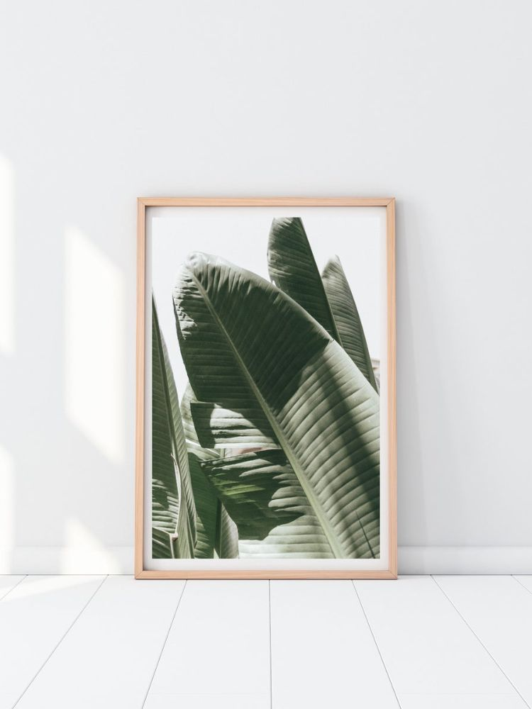wooden frame with print of banana leaves