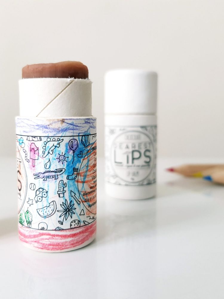 Coloured in tube of lip balm