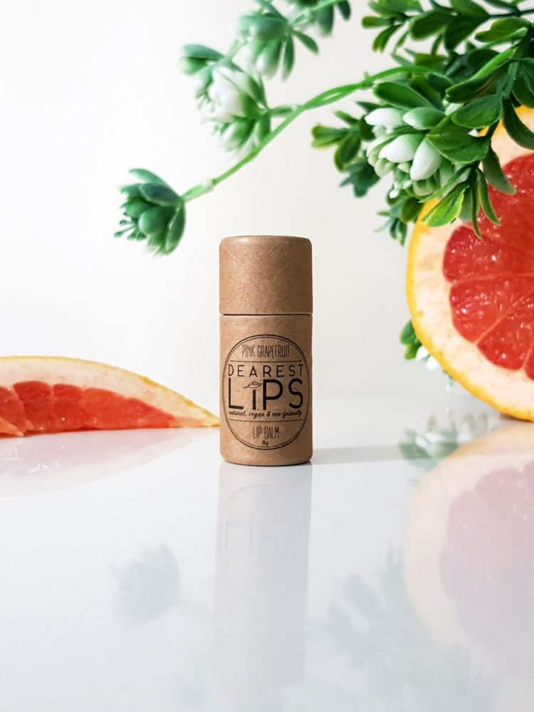 Picture of eco friendly lip balm with slices of pink grapefruit