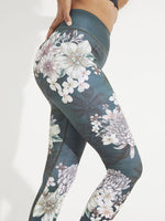 Close up of the Dharma Bum full length leggings, dark grey with floral print