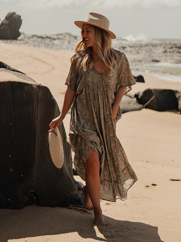 Lady on the beach in long sage green floral dress