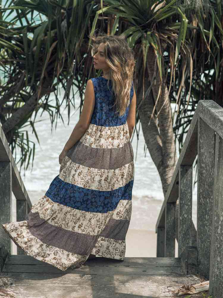 Girl on Stairs at beach with pretty dress