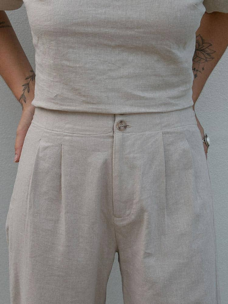 Pleated waist detail on the Dreamers and Drifters linen chino pants