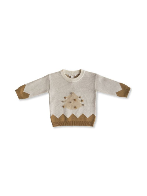 Flat lay of Christmas tree knitted jumper
