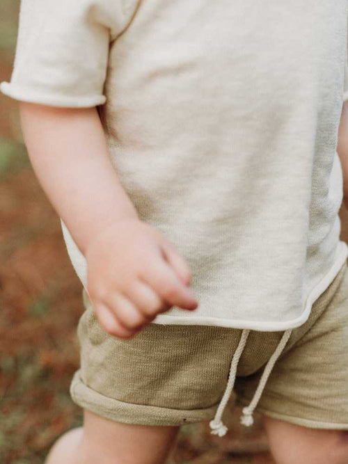 Close up of organic knitted kids shorts and tee shirt