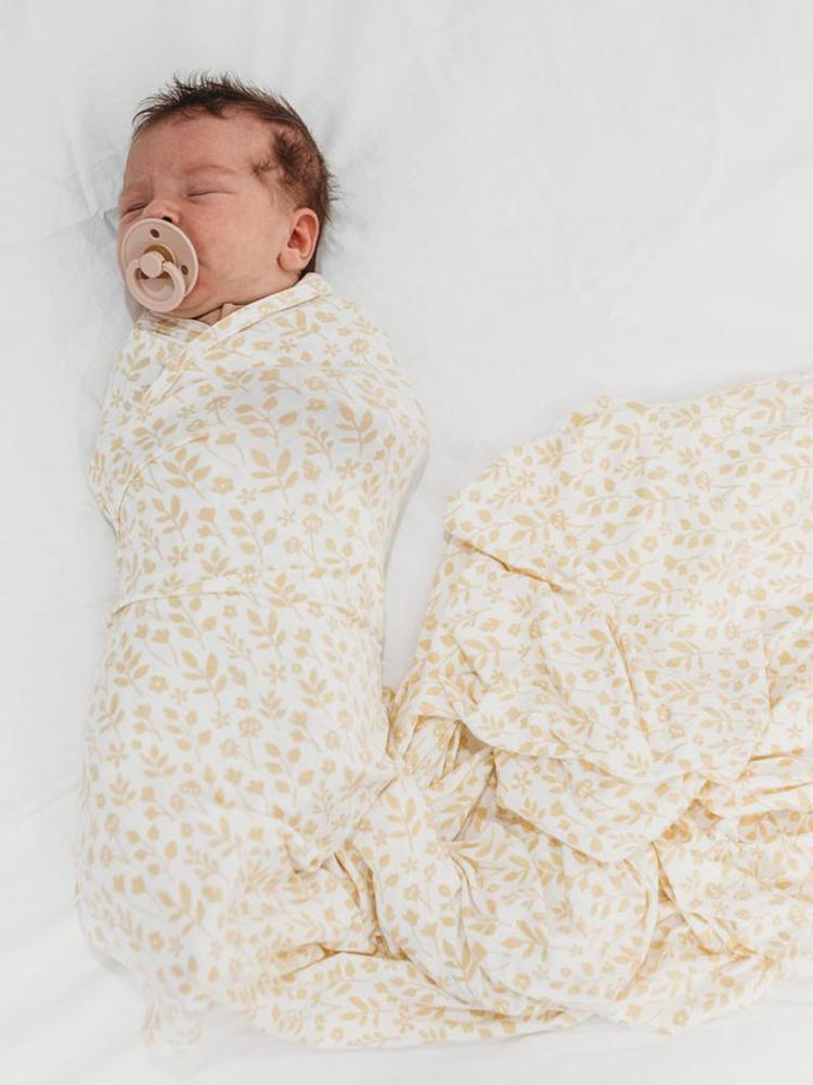 Baby wrapped in Halo and Horns organic bamboo jersey swaddle