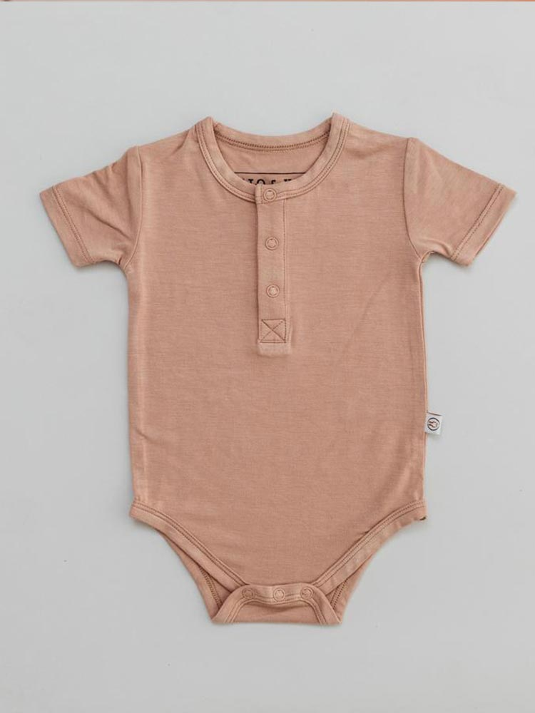 Dusty orange coloured baby onesie by Halo and Horns