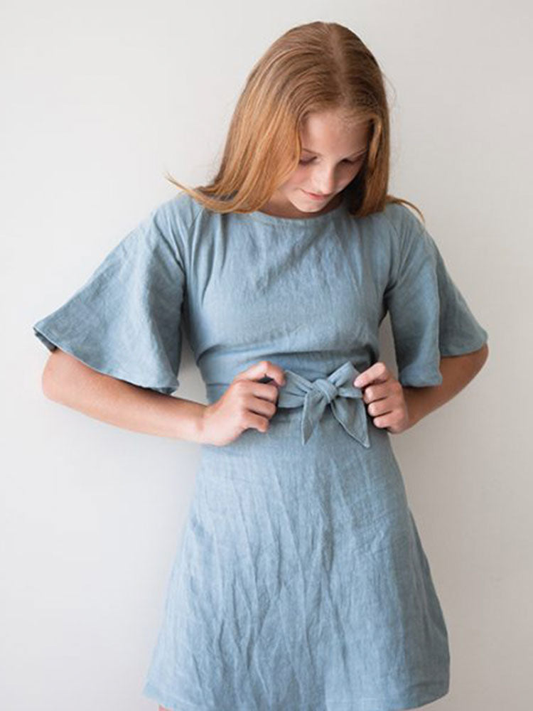 Batwing sleeves and waist tie bow on light blue linen dress