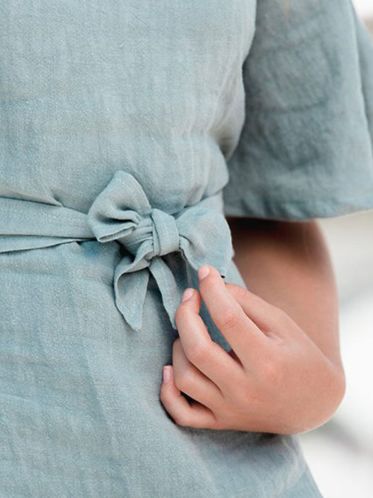 Close up of linen bow on the Hendrik Clothing Co Fly Away With Me Dress