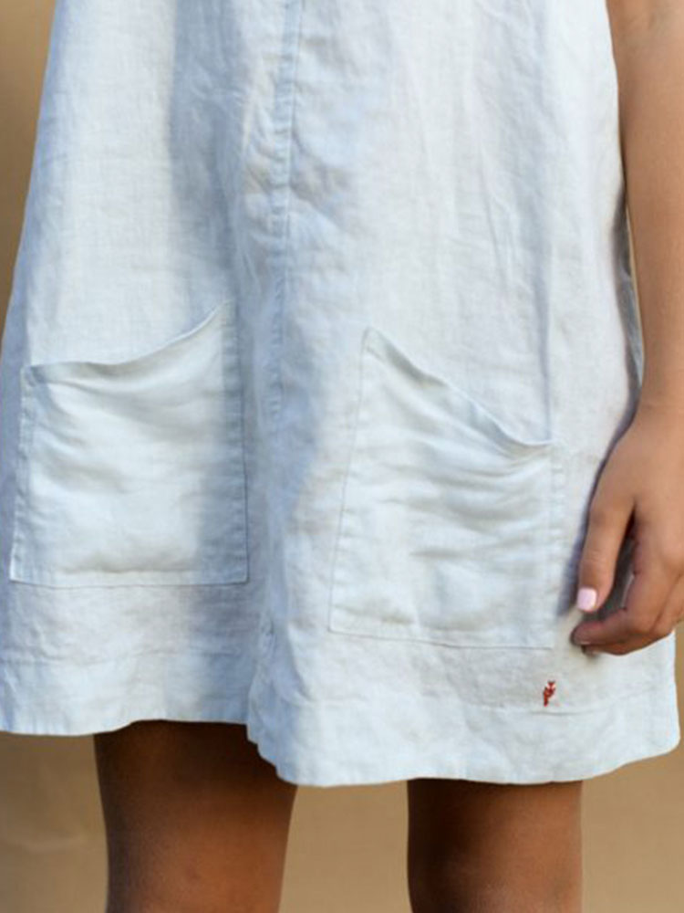 Knee length white linen girl's dress by Hendrik Clothing Co