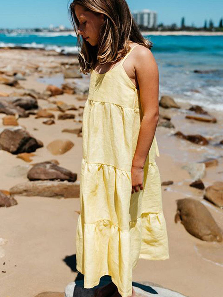 Yellow ankle-length linen dress with drop tiers and thin straps