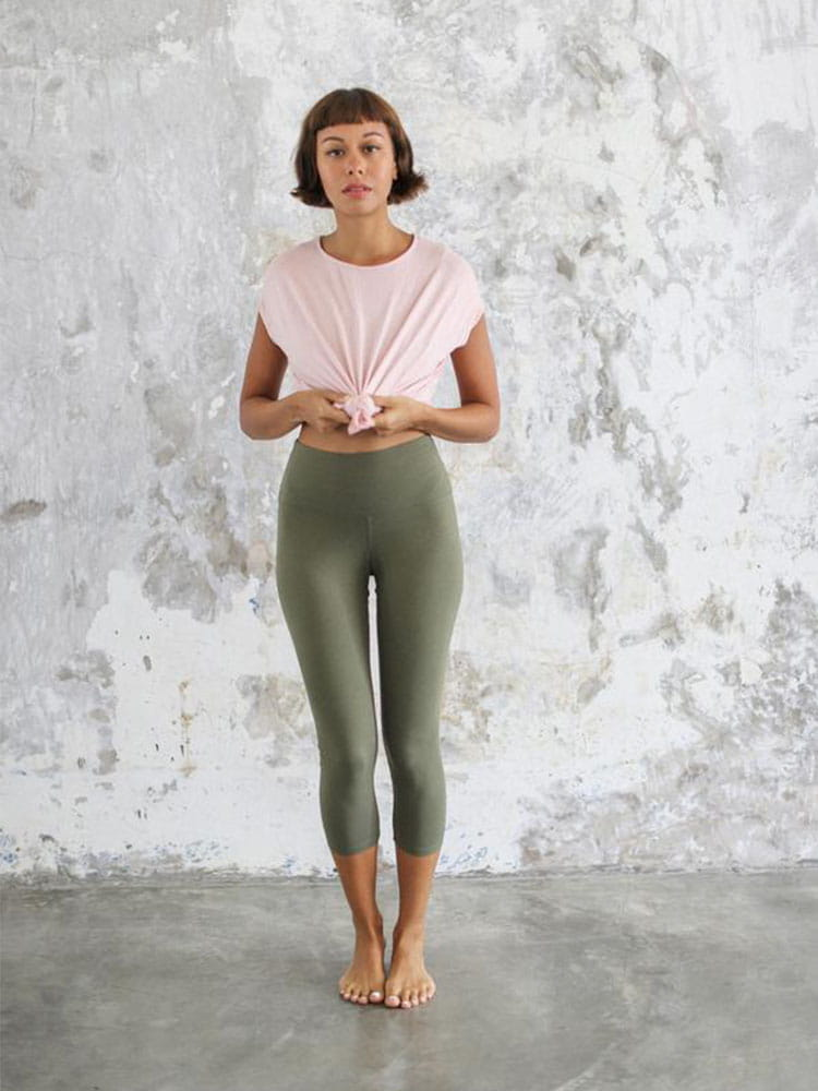 Woman wears Indigo Luna Ananda Capri in Kale