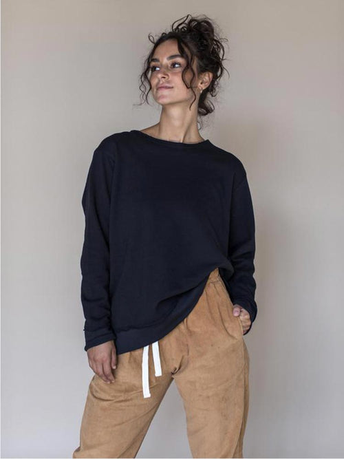 Young lady wears the Indigo Luna Ananda Crew Black