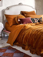 Close up of pretty bed in mustard linen
