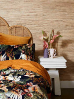 Beautiful wicker bed with night jungle print bed linen