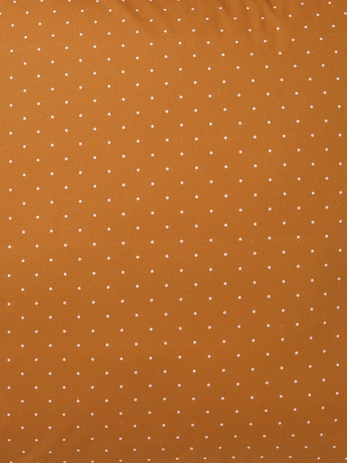 Close up of material poka dot in mustard