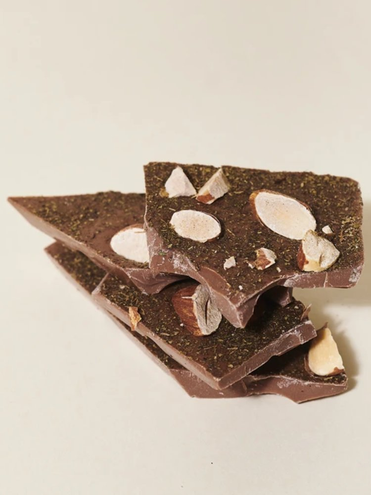 a-pile-of-pieces-of-broken-dark-chocolate-with-almonds