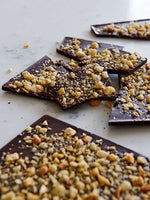 Scattered-shards-of-dark-chocolate-covered-in-almonds-and-wattleseed