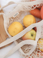 Lemons, apples and carrots in a Kappi grocery bag
