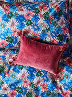 Kip & Co dark pink velvet cushion on floral sheets